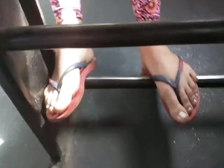 Teen girl feet on public bus