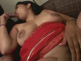 Indian slut gets to suck a big black part1