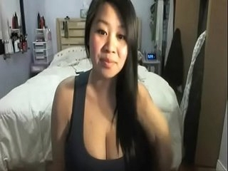 Busty asian teases her white bf on cam